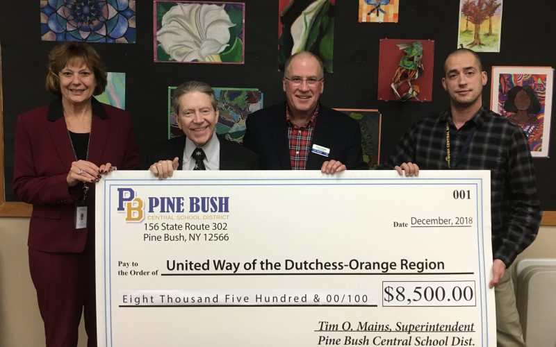 A group of Pine Bush district employees present a giant ceremonial check to the United Way campaign