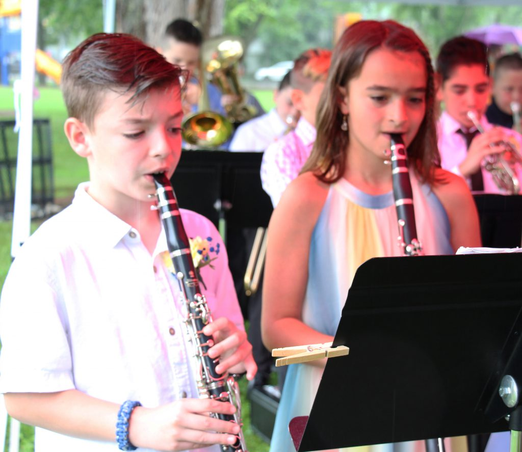 A fifth grade boy and girl play oboes