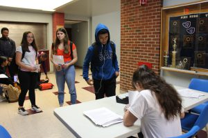 A line forms for students wanting to sign up to give blood.